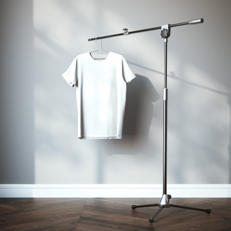 indoors: White t-shirt hanging on the tripod stand. 3d rendering Stock Photo