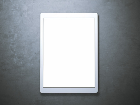 concrete floor: Blank white tablet on the concrete floor