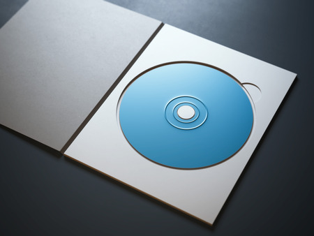 blue ray: Opened package with blue ray disc on dark background Stock Photo