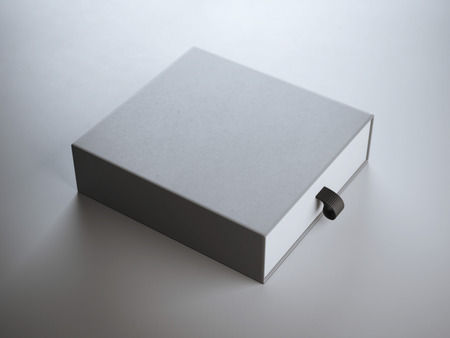 packaging box: Square gray box in the white studio