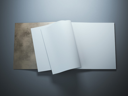 book cover: Open blank notebook with curled sheets in gray studio.