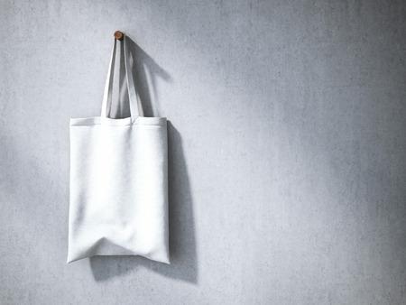 tela algodon: bolsa de algodón blanco en la pared de hormigón gris. Representación 3D