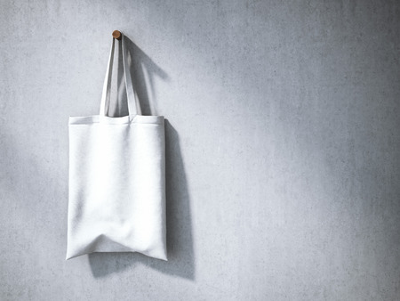White cotton bag on the gray concrete wall. 3d rendering