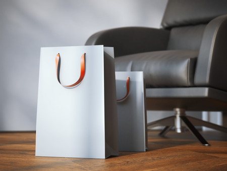 Two shopping bags near modern black armchair on the wooden floor. 3d rendering