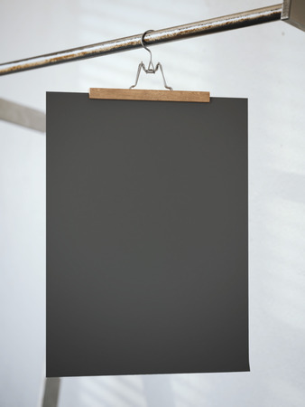 store sign: Trouser hanger with black blank paper sheet. 3d rendering