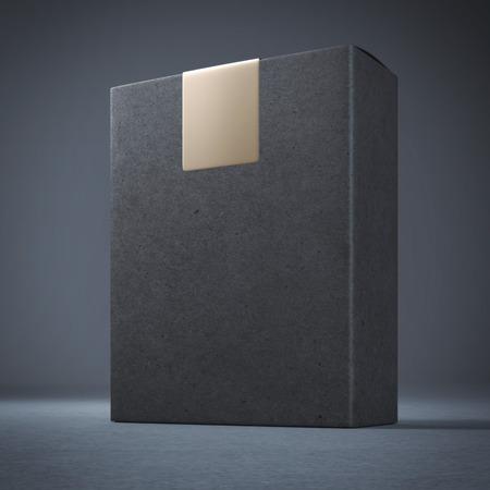 matt: Black box with golden sticker in the dark studio Stock Photo