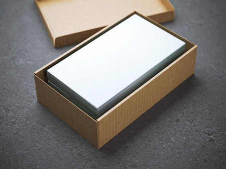 段ボールのパッケージに、ビジネス カードのスタック 写真素材