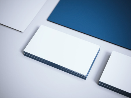 workpiece: Two stacks of business cards with blue paper sheet