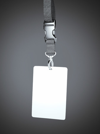 neckband: White blank badge with neckband hanging in gray studio Stock Photo
