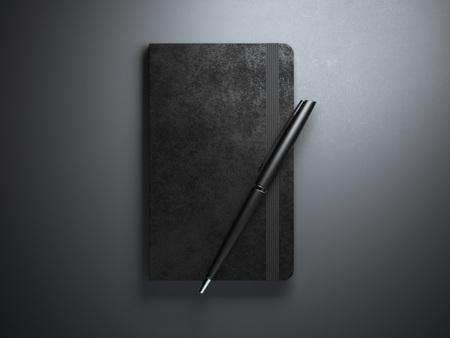 diary: Black copybook with pen in dark studio Stock Photo