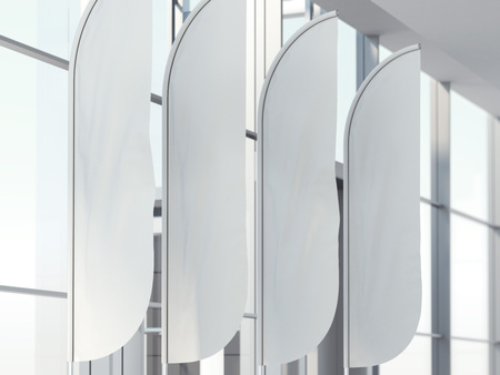 Four vertical wind banners in bright office interior. 3d rendering