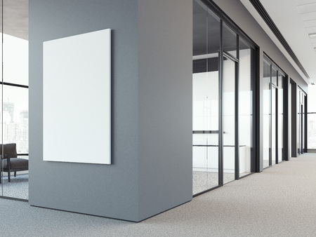 灰色のオフィスの壁に空白のポスター。3 d レンダリング