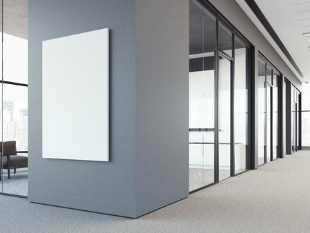 사무실 회색 벽에 빈 흰색 포스터. 3d 렌더링