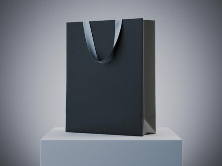 Black shopping bag on white podium in studio. 3d rendering