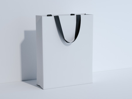 White shopping bag in bright studio. 3d rendering Stock Photo