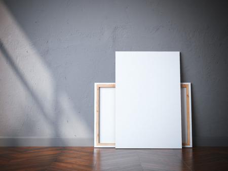 Dos lienzos blancos en el piso de madera en un interior moderno. Representación 3D