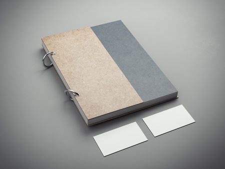 moleskin: Notebook with two blank business cards. 3d rendering