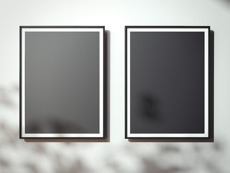 black shadows: Blank black canvases on the white wall with shadows. 3d rendering