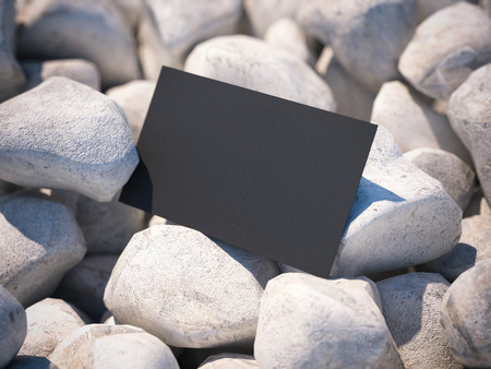 white pebble: Black business card on white pebble. 3d rendering Stock Photo