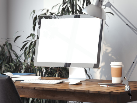 Workspace with blank screen on a table. 3d rendering 스톡 콘텐츠