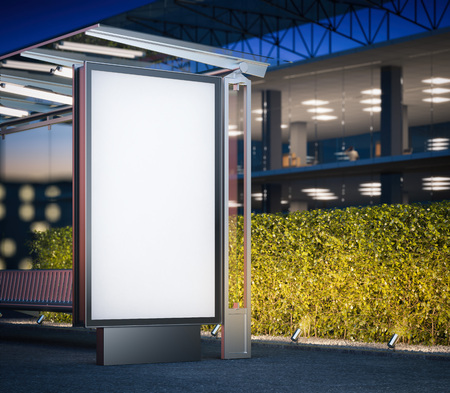 Modern bus stop with blank billboard near office building at night. 3d rendering Banque d'images