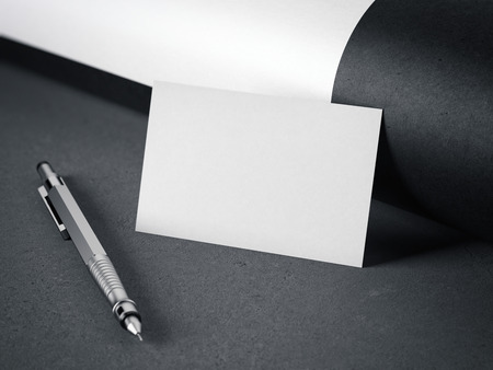 adress: White blank business card with pen on gray floor. 3d rendering