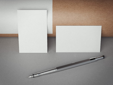 adress: Two white blank business cards with pen on gray floor. 3d rendering