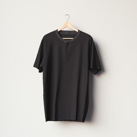 Nero maglietta in bianco su un appendiabiti in legno nella stanza luminosa. rendering 3D
