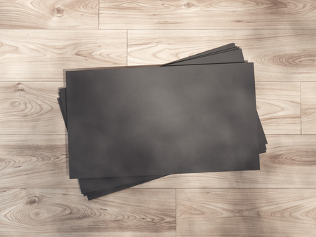 black shadows: Black business card on a wooden floor with shadows. 3d rendering