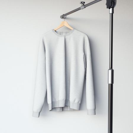 casual hooded top: Gray blank sweatshirt on modern metal hanger. 3d rendering