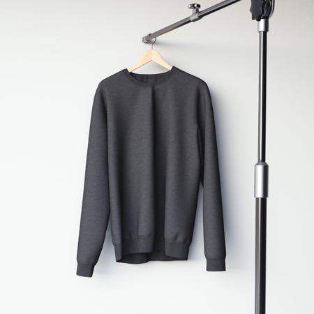 casual hooded top: Black blank sweatshirt on modern metal hanger. 3d rendering
