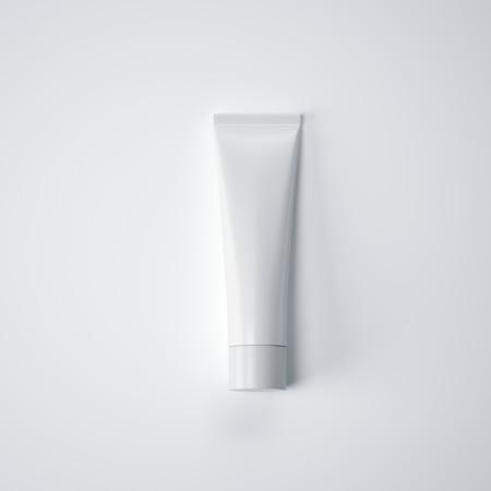 rendering: White blank cream tube on a white floor. 3d rendering Stock Photo