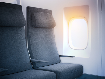 illuminator: Dark airplane seats in the cabin with bright window. 3d rendering