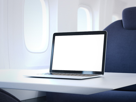 illuminator: Laptop with blank screen on the table in a luxury airplane cabin. 3d rendering