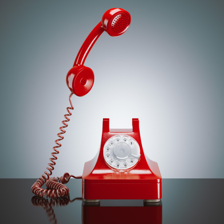 Red retro phone in a modern studio. 3d rendering