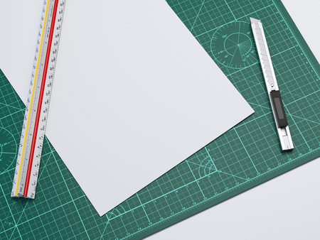 Green cutting mat with blank paper sheet, cutter and reuler. 3d rendering Stock Photo