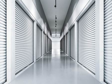 Storage facilities with white doors. 3d rendering Фото со стока