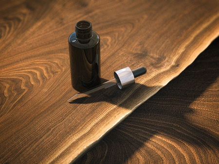 Bottle with pipette on the table. 3d rendering
