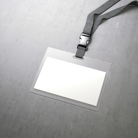 White badge with ribbon on a concrete floor. 3d rendering Stock Photo