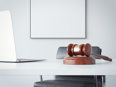Office table with a hammer of the judge. 3d rendering Stok Fotoğraf