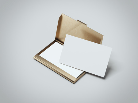 White business cards with golden holder. 3d rendering