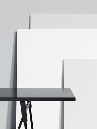 Black empty table and three blank picture frames. 3d rendering 스톡 콘텐츠