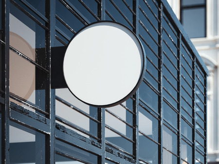 Blank round signboard on the modern wall. Store entrance. 3d rendering
