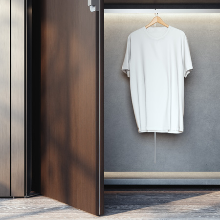 Wardrobe with blank white t-shirt on hanger. 3d rendering Stock Photo