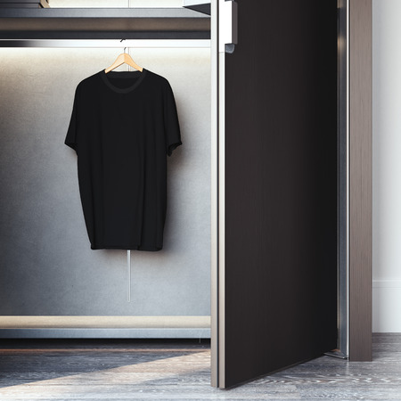 Wardrobe with blank black t-shirt on hanger. 3d rendering