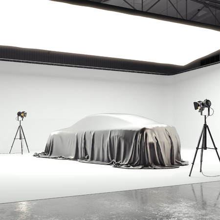 Photographic studio with covered car and several light sources. 3d rendering Reklamní fotografie