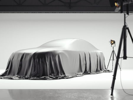 Photographic studio with covered car and several light sources. 3d rendering Banco de Imagens