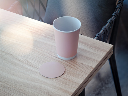 Pink coffee cup and coaster mockup lying on the wooden table, 3d rendering Stok Fotoğraf