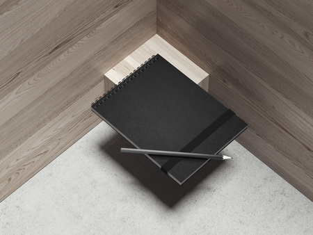 Black notepad and black pen on the wooden background, 3d rendering Фото со стока