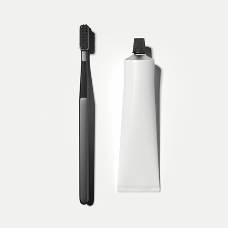White toothpaste tube and black toothbrush on white background, 3d rendering Banco de Imagens